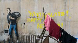 Steve Jobs devine graffiti pentru a-ți arăta că problema refugiaților e reală